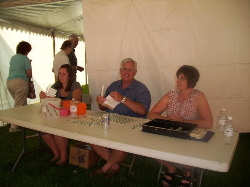 Rachelle, Bob and Diane take tickets