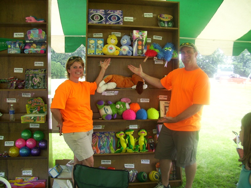 Kurt and Tricia show off the prizes